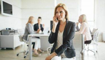 Businesswoman busy at company office meeting